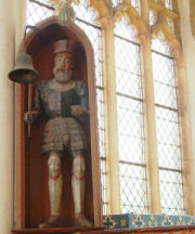 Rare Jack-o'-the-clock, a painted wooden figure, in armour, in Holy Trinity Church, Blythburgh.